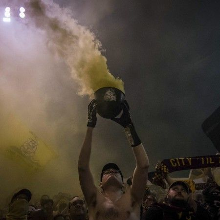 Drew Gentry (aka. Sergeant Scary) holds his helmet full of smoke bombs after Detroit City FC's first match at Keyworth Stadium in 2016. Gentry is the head capo of the Northern Guard Supporters, the main supporter group of DCFC. The Northern Guard is known nationwide for their intense atmosphere and unrelenting support of the semi-pro soccer club.